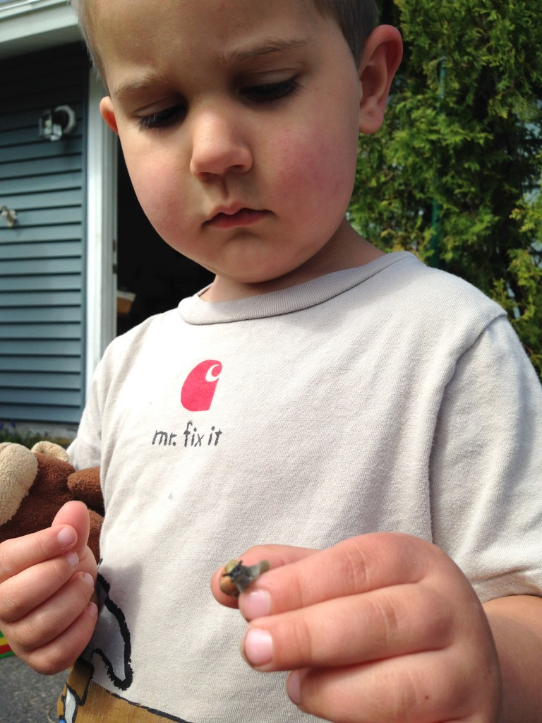 Anthony shows off the snail he found.