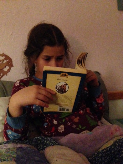 Bella reading Little House in the Highlands