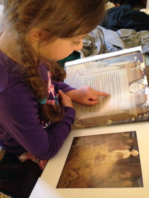 Sophie reading The Easter Story