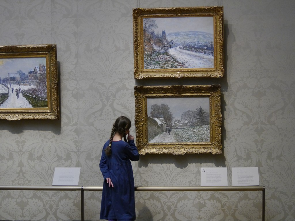Bella looks at Monet's snowy landscapes