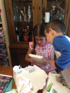 Bella's birthday, Anthony examines a book.