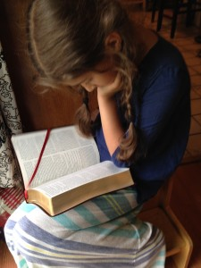 Bella loves her new Bible. Reading the Psalms and Revelation.