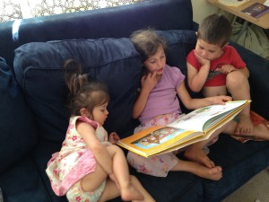 Sophie reads to Lucy and Anthony