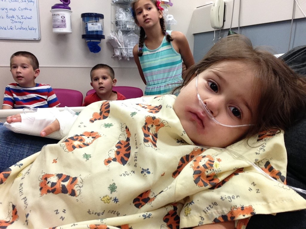 Sick, listless Lucy stares into space in the emergency room while the other kids watch Madagascar.