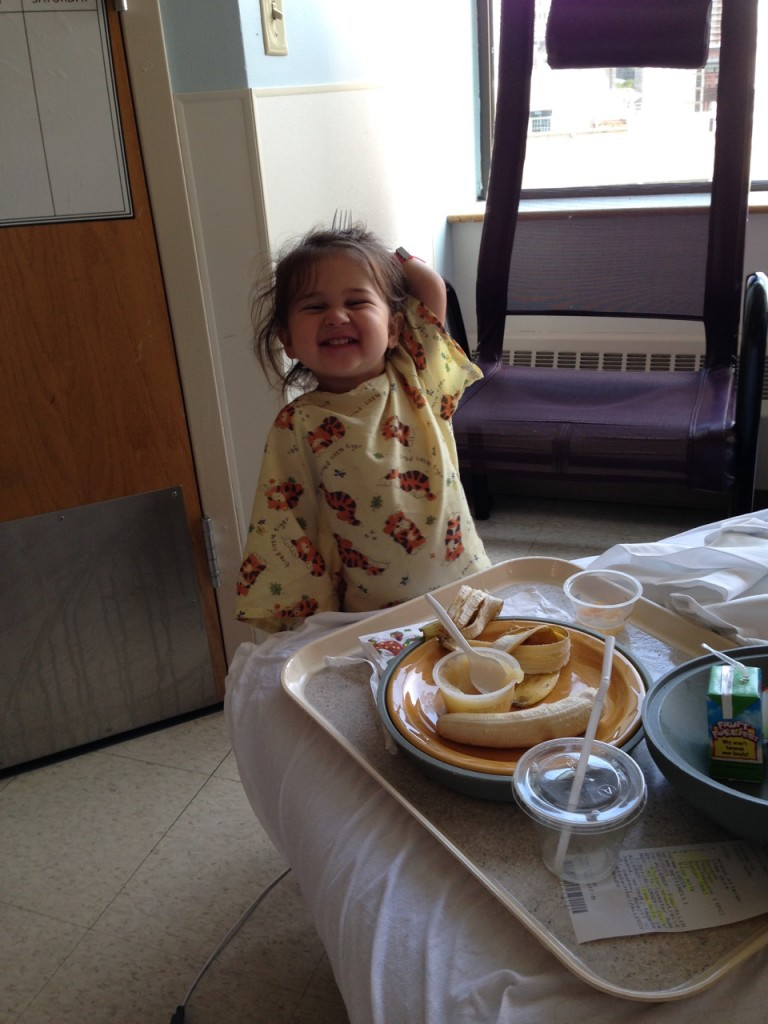 On her feet and eating a late breakfast.