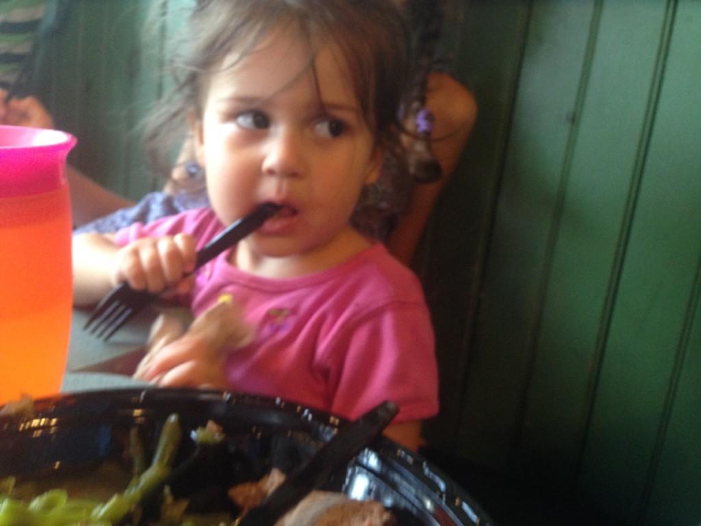 Lucy enjoys her BBQ dinner.