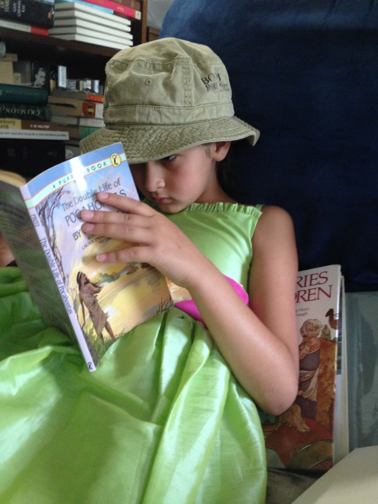 Bella reading after Mass on Sunday.