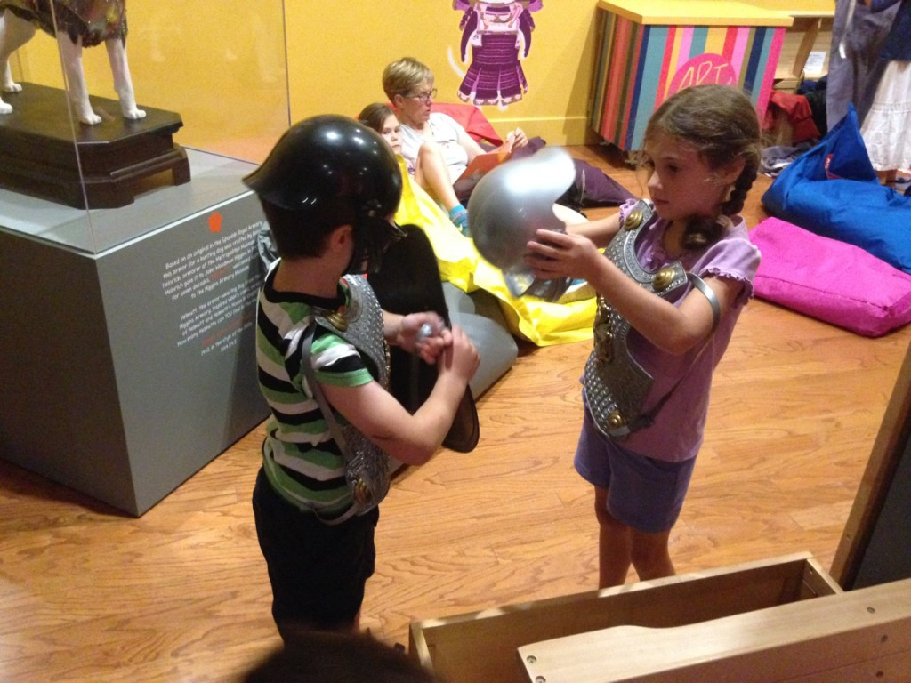 Ben and Sophie try on armor at the Worcester Art Museum
