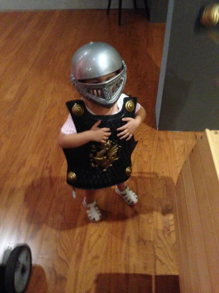 Lucia tries on armor at the Worcester Art Museum.