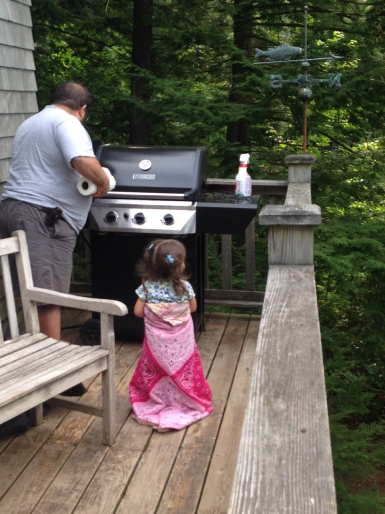 King Lucy watches Daddy grill.
