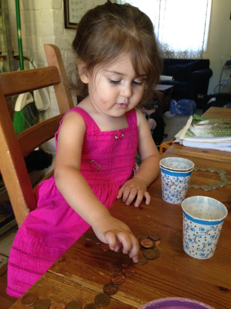 Lucy counts coins