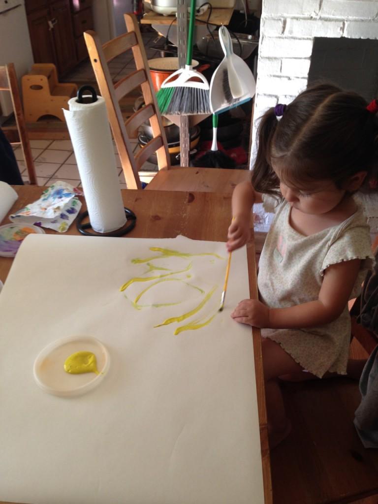 Lucy paints.