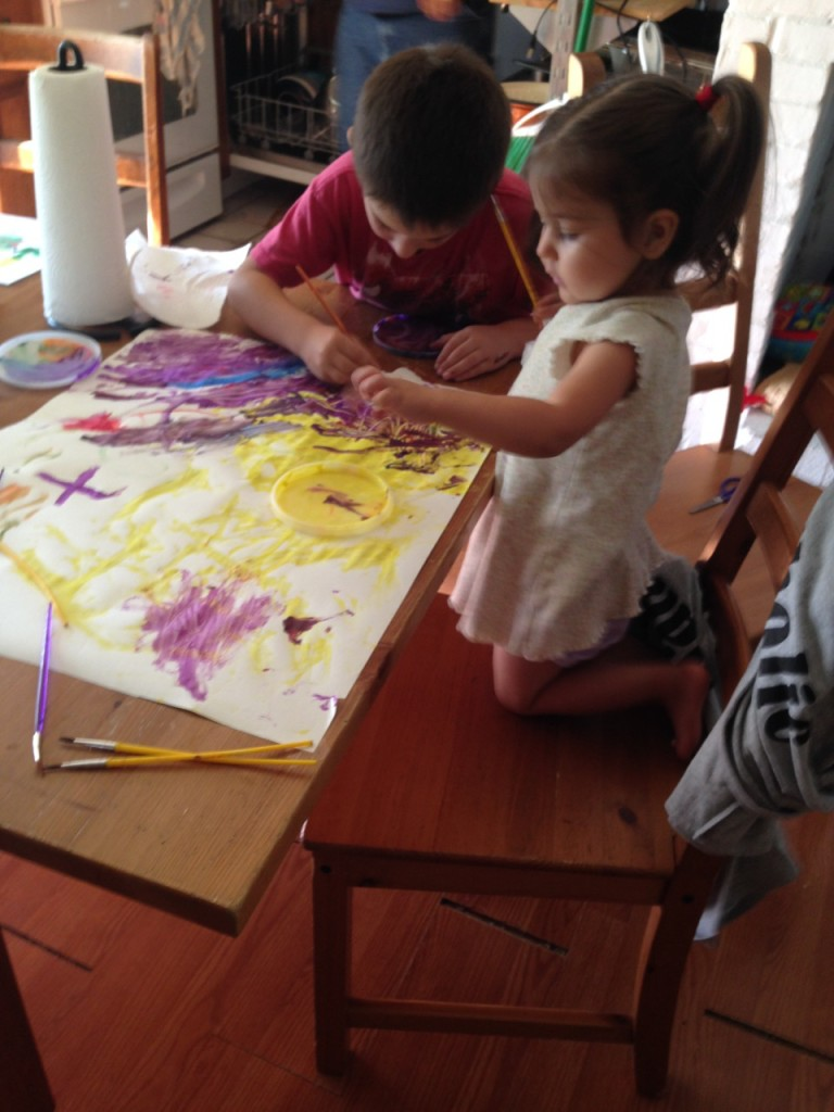 Ben paints with Lucy.