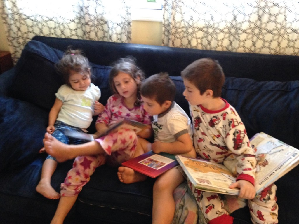 Sophie reads to Lucy and the boys forget their own books.