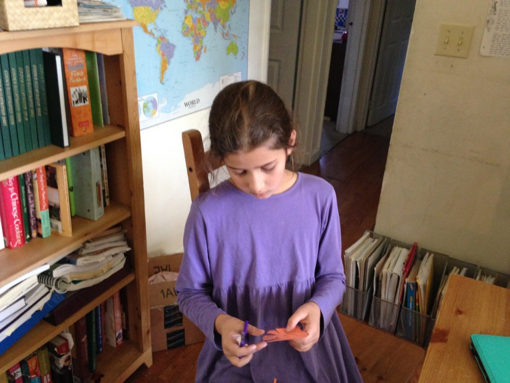 Bella makes paper spiders and sings Bilbo's Attercop song.