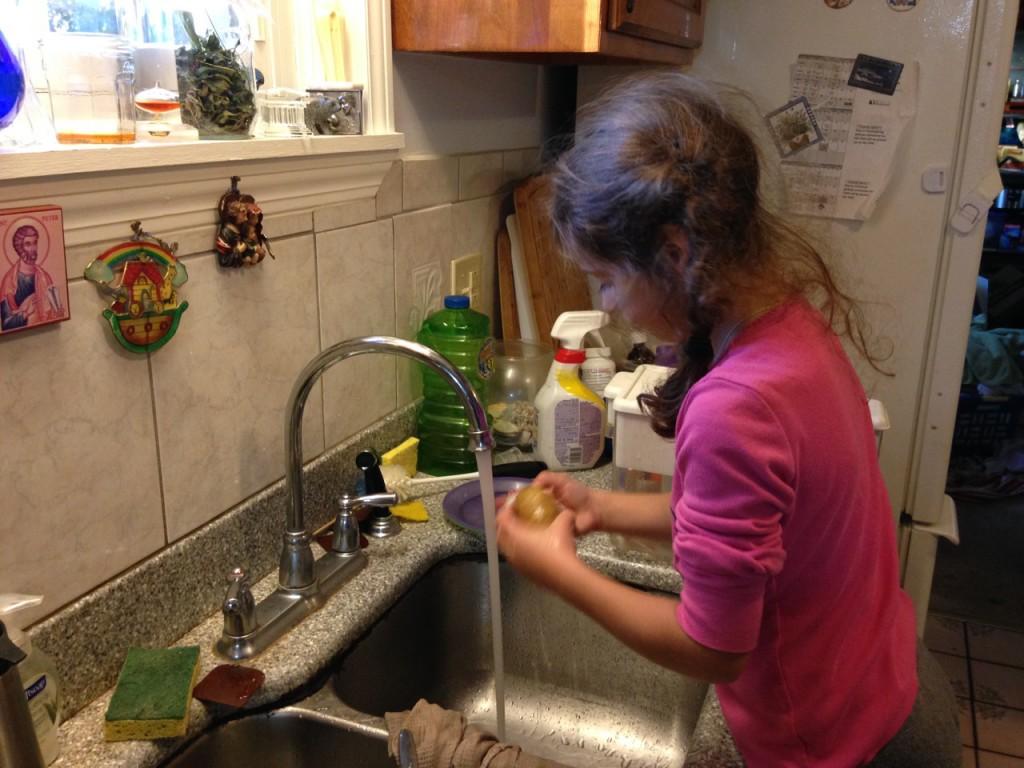 Sophie scrubs potatoes
