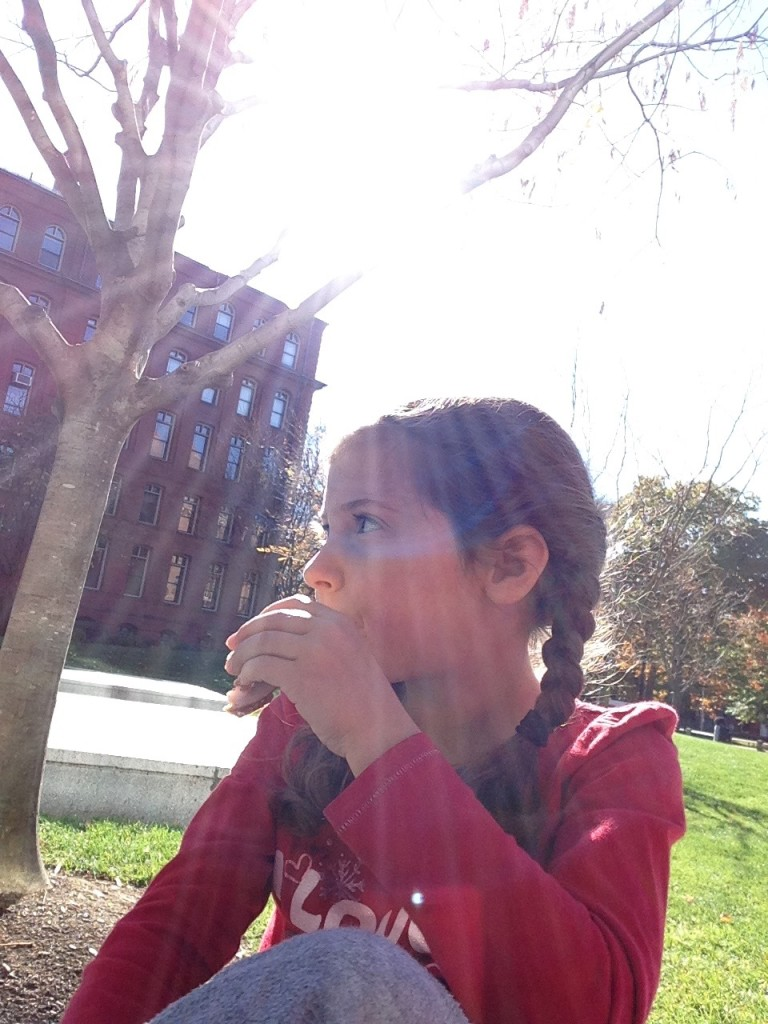 Lunch break in the sun: Sophie with a sandwich.