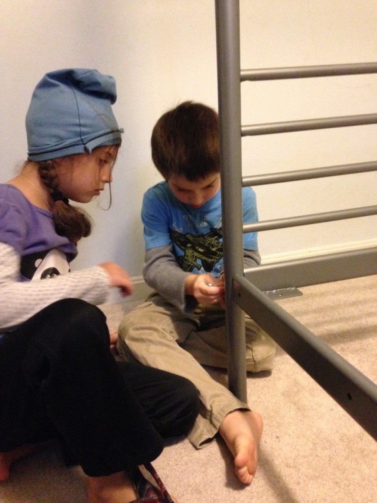 Sophie the ninja and Ben tighten the screws on the new bunkbeds.
