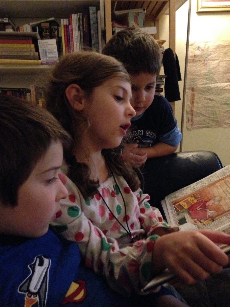 Sophie reads to the boys.