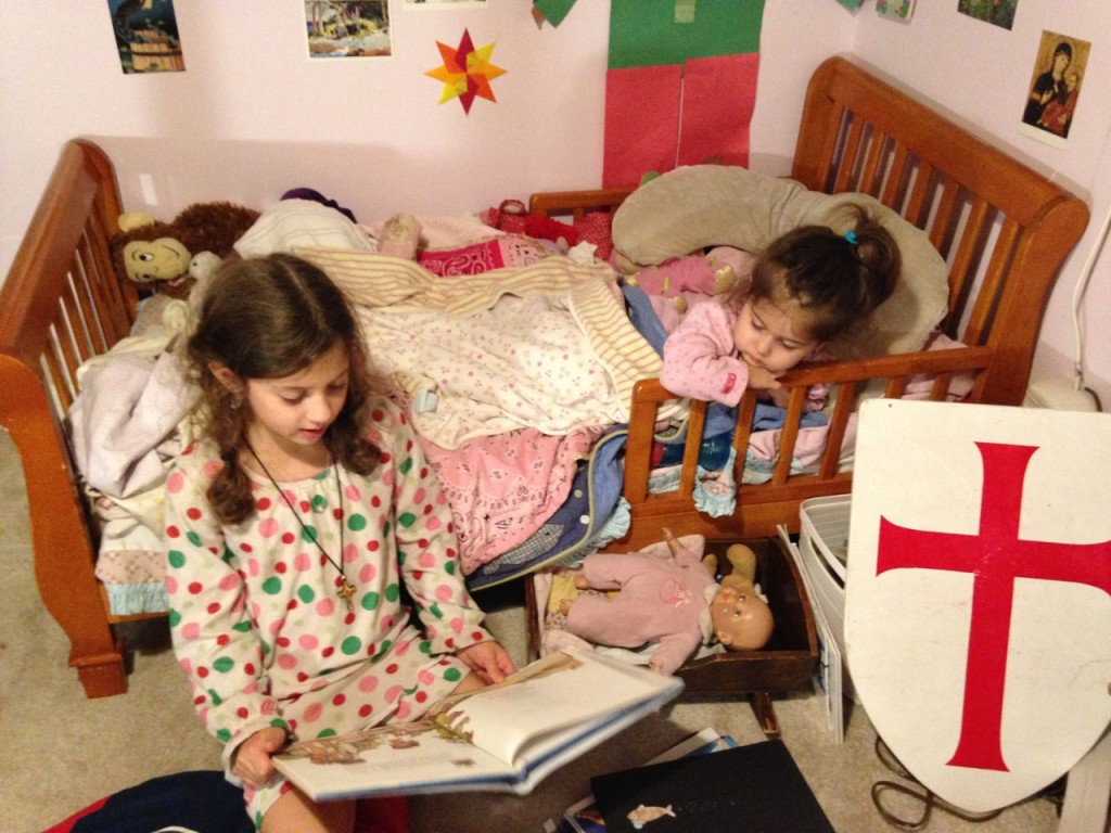 Sophie reads to Lucy.