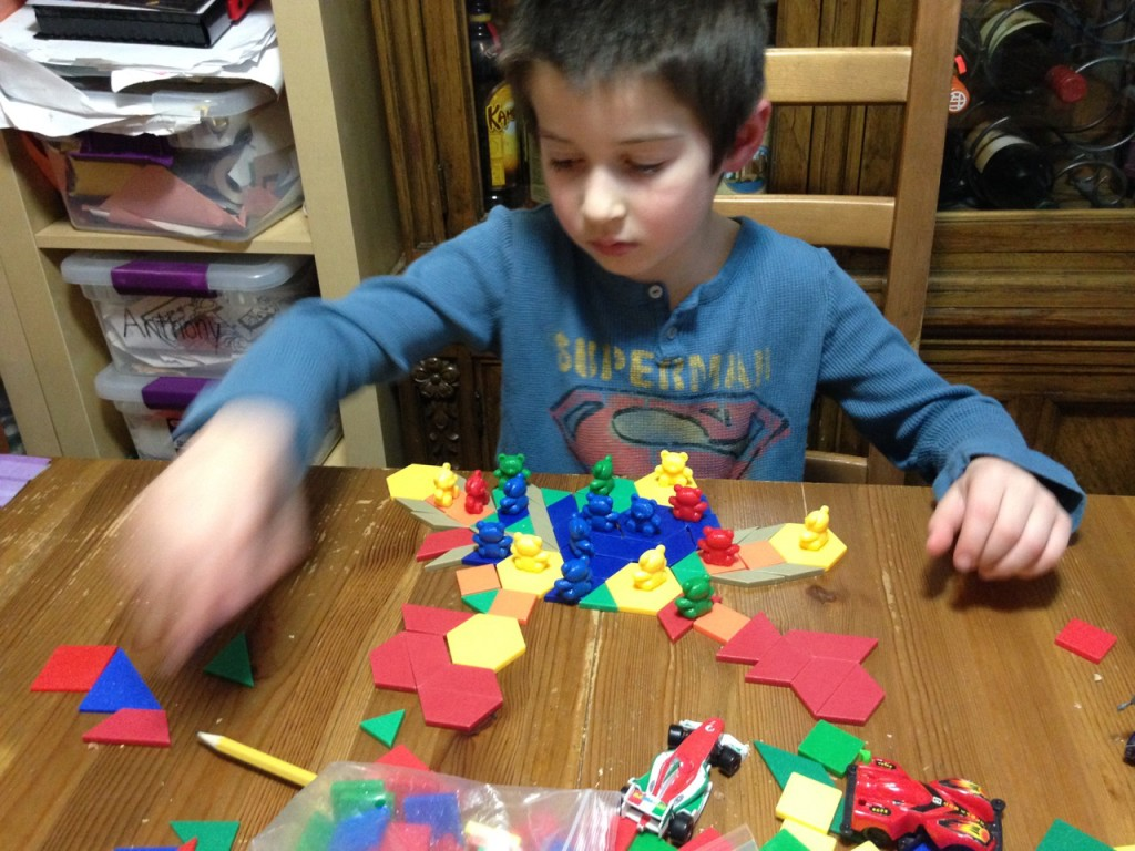 Ben plays with pattern blocks and bears.