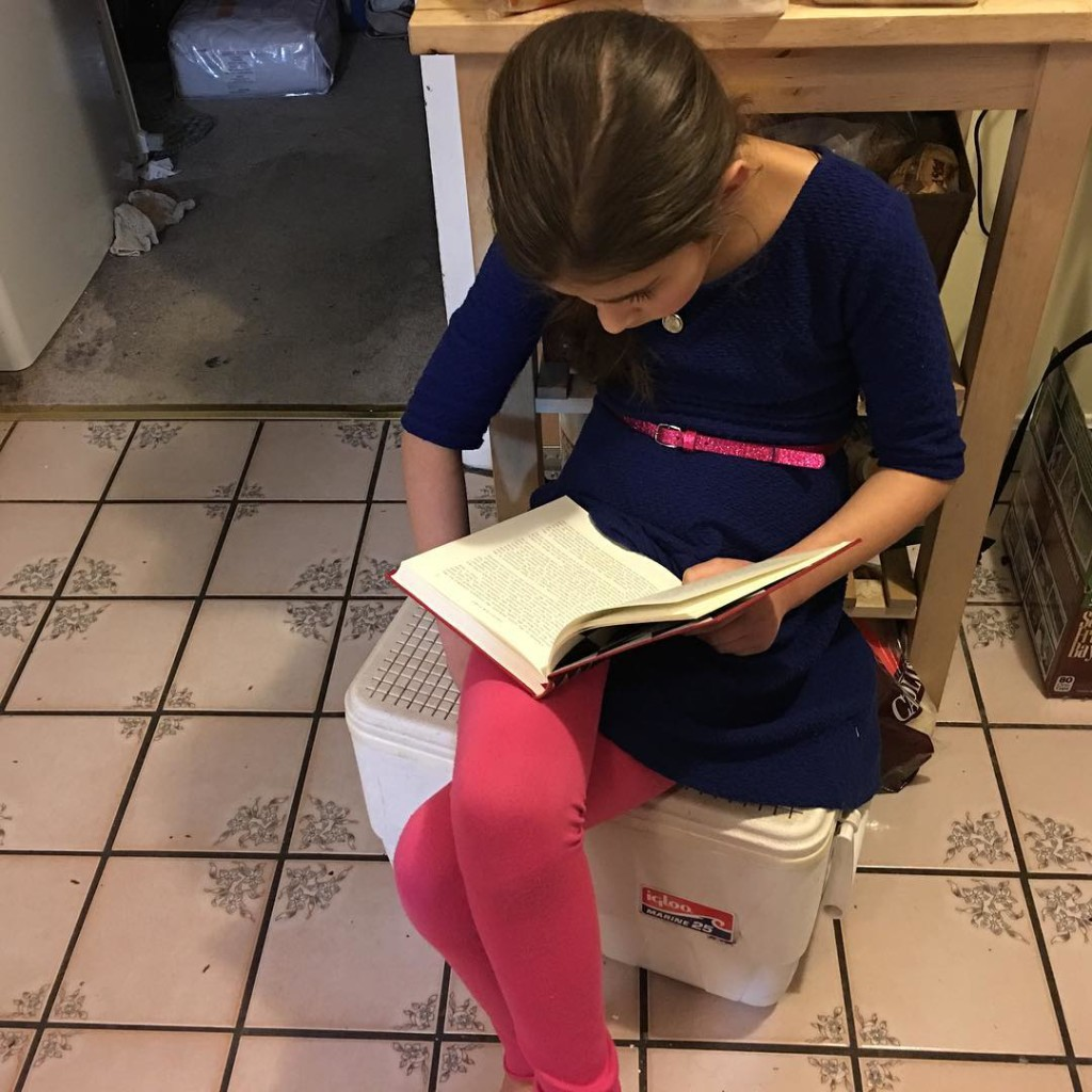 Reading in the kitchen.