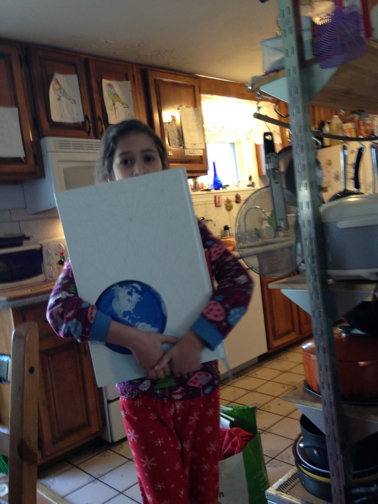 Bella with the atlas