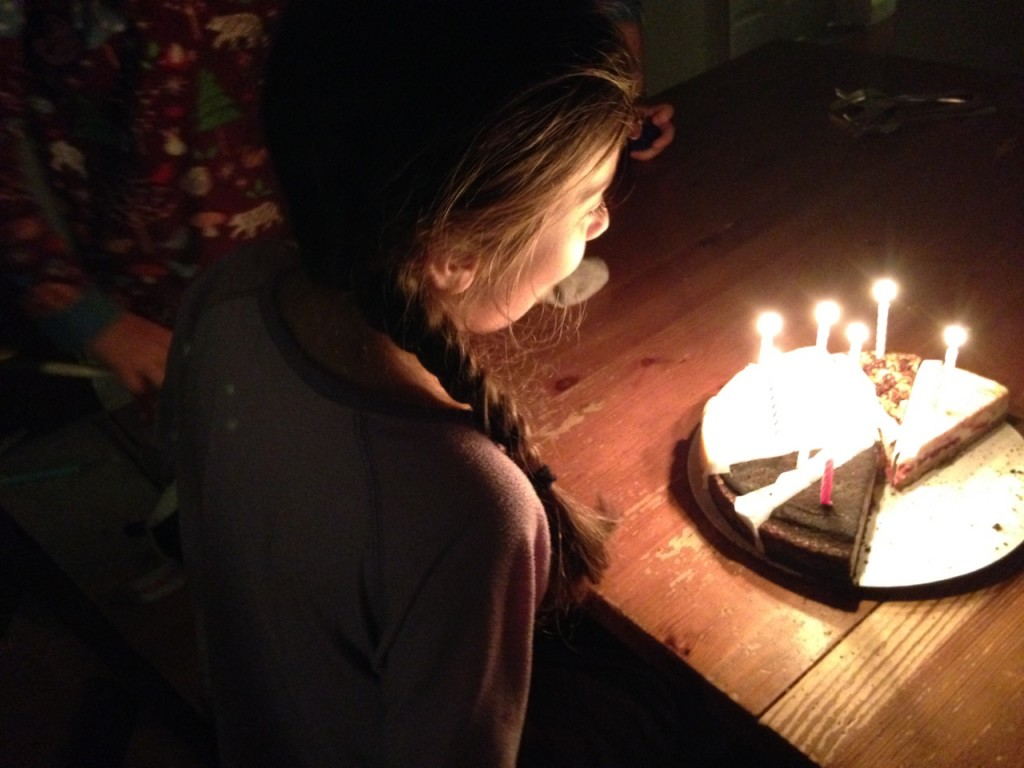 Sophie's birthday: candles on cheesecake.