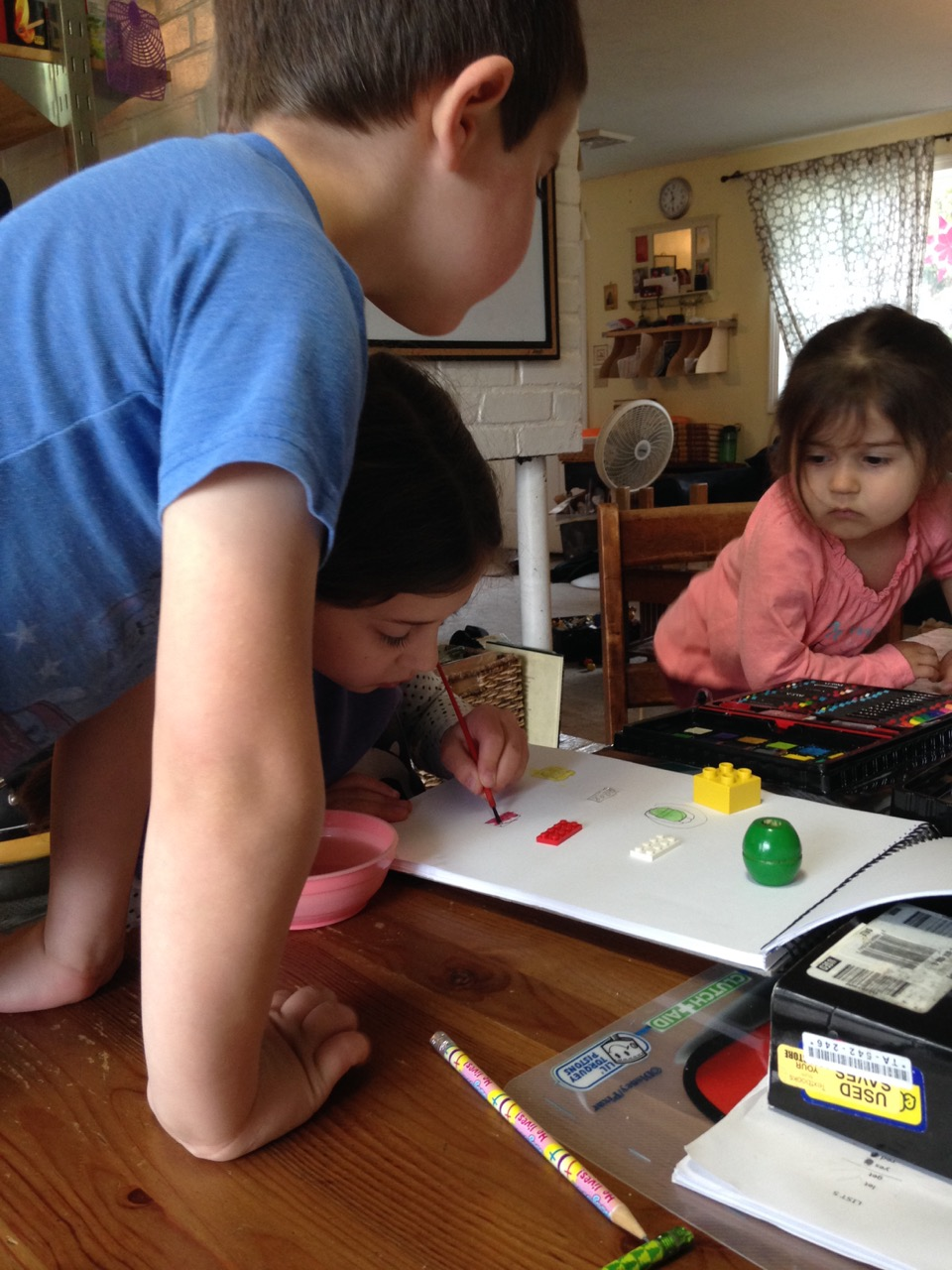 Anthony and Lucy watch Sophie sketching and painting.