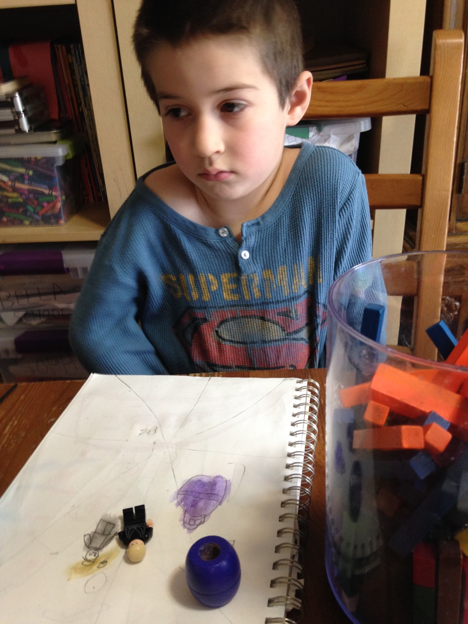 Ben sketches and paints his Lego Luke and a bead.