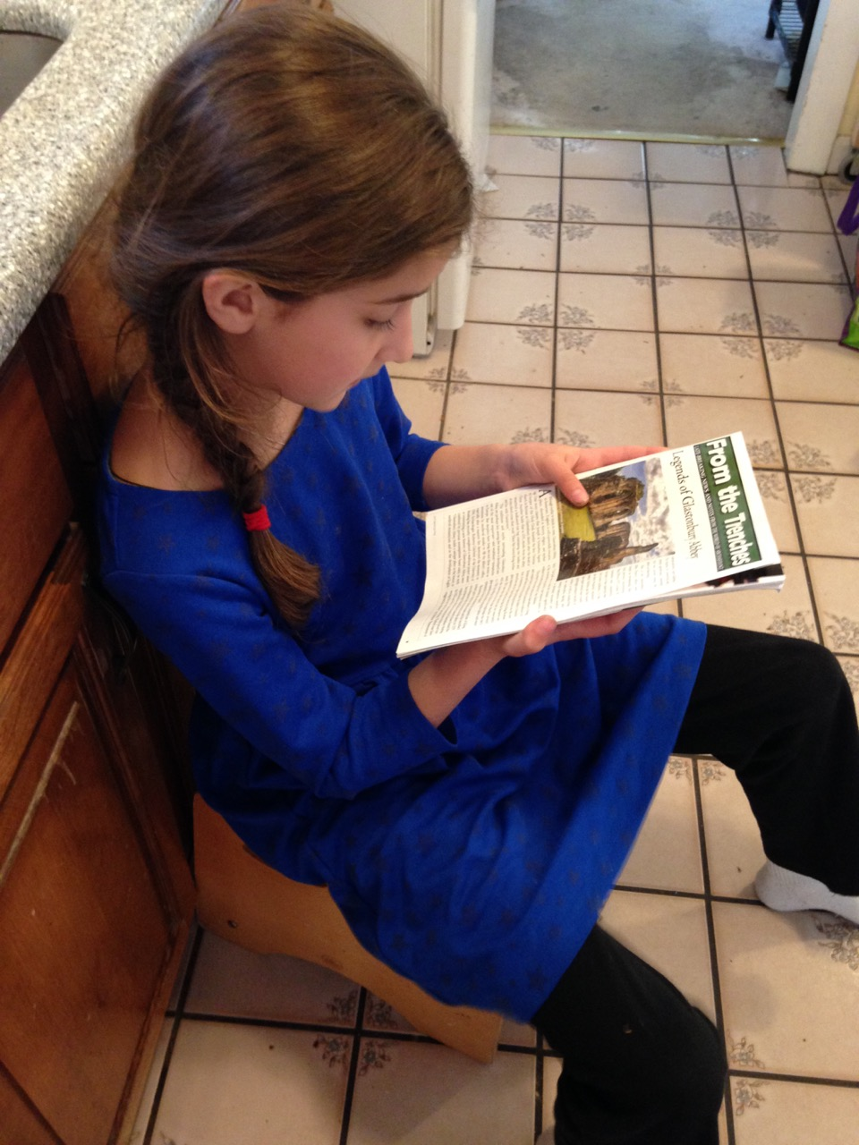 Bella reads to me from her new Archaeology Magazine.
