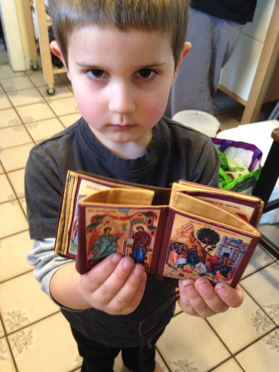 Anthony with Lucy's icon book.