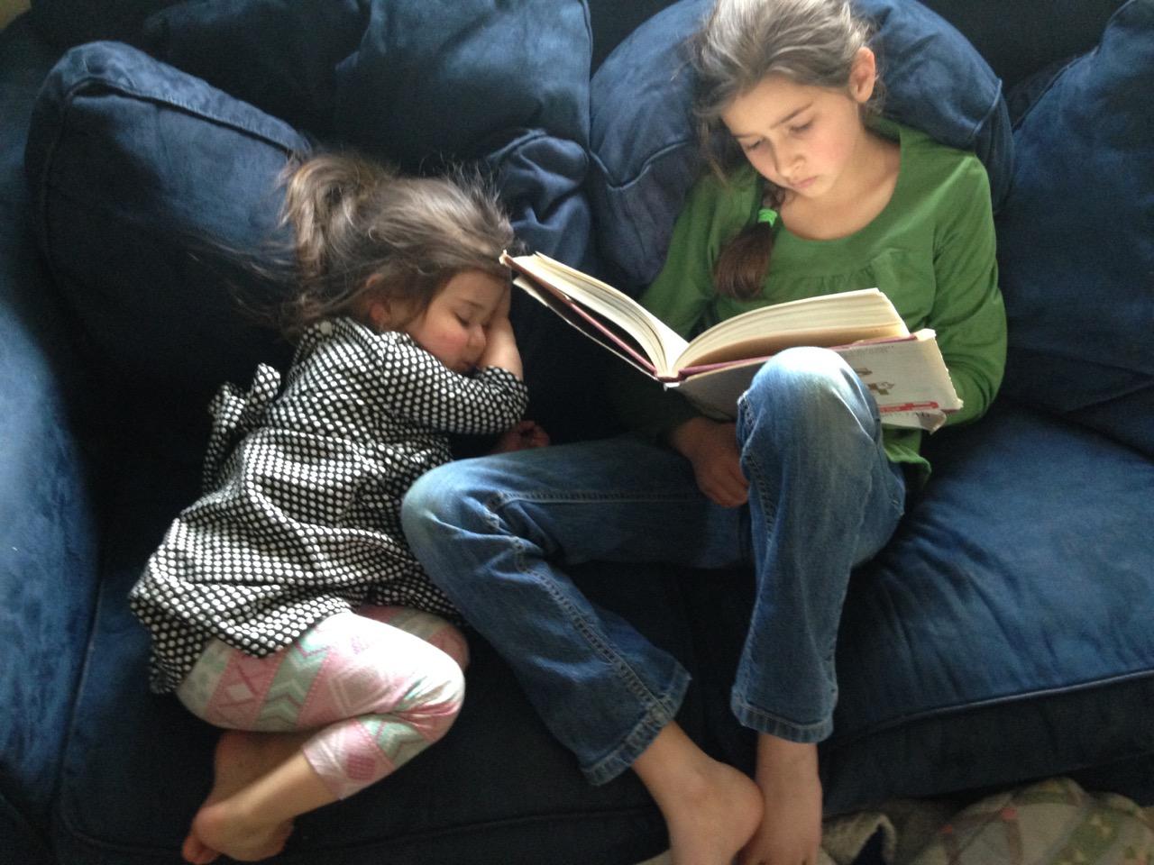 Bella reads, Lucy dozes.