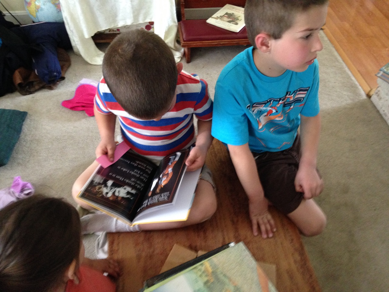 Anthony reads me the Star Wars book he got from the library.