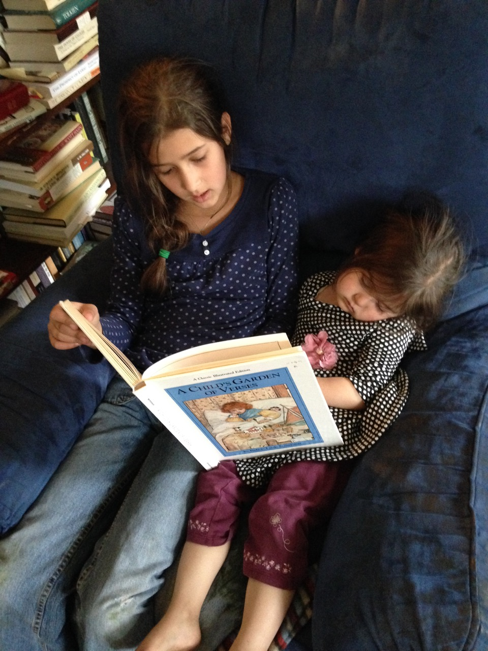 Bella reads poetry to Lucy, who fell asleep.