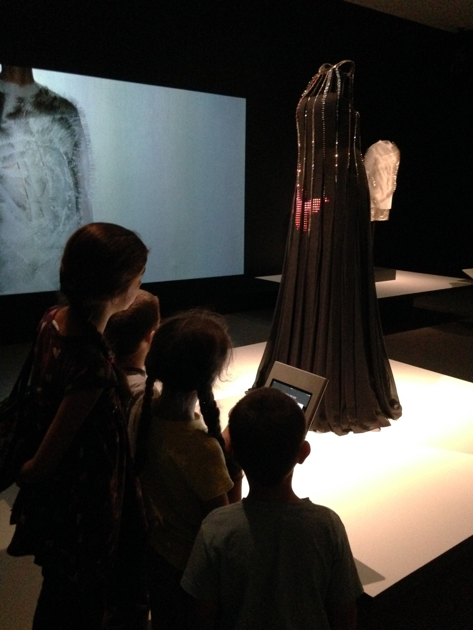 A dress with digital lights display controlled from a tablet. In the #techstyle exhibit