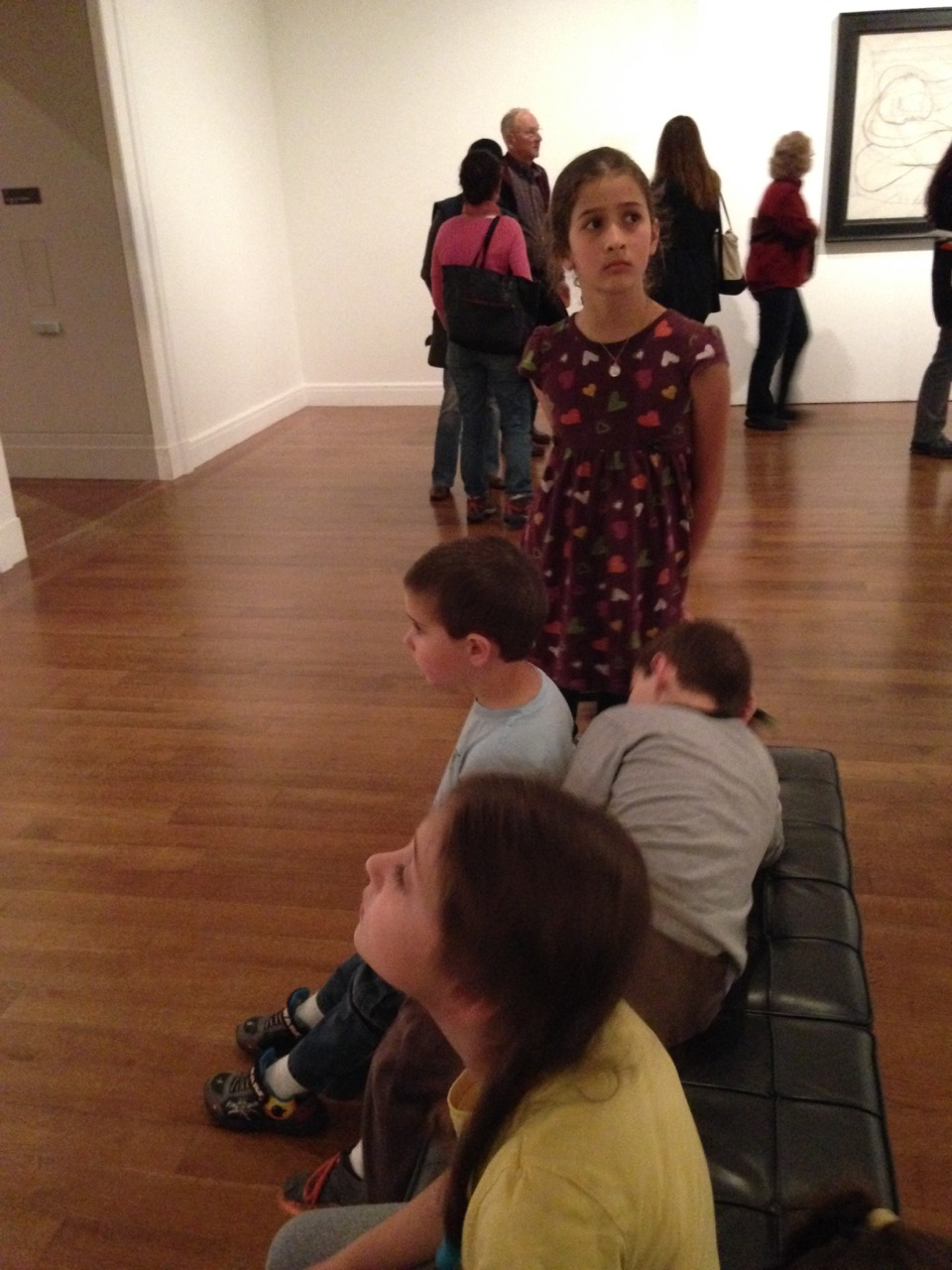 Everyone else plopped down to wait while Sophie and I explored the world of Picasso.