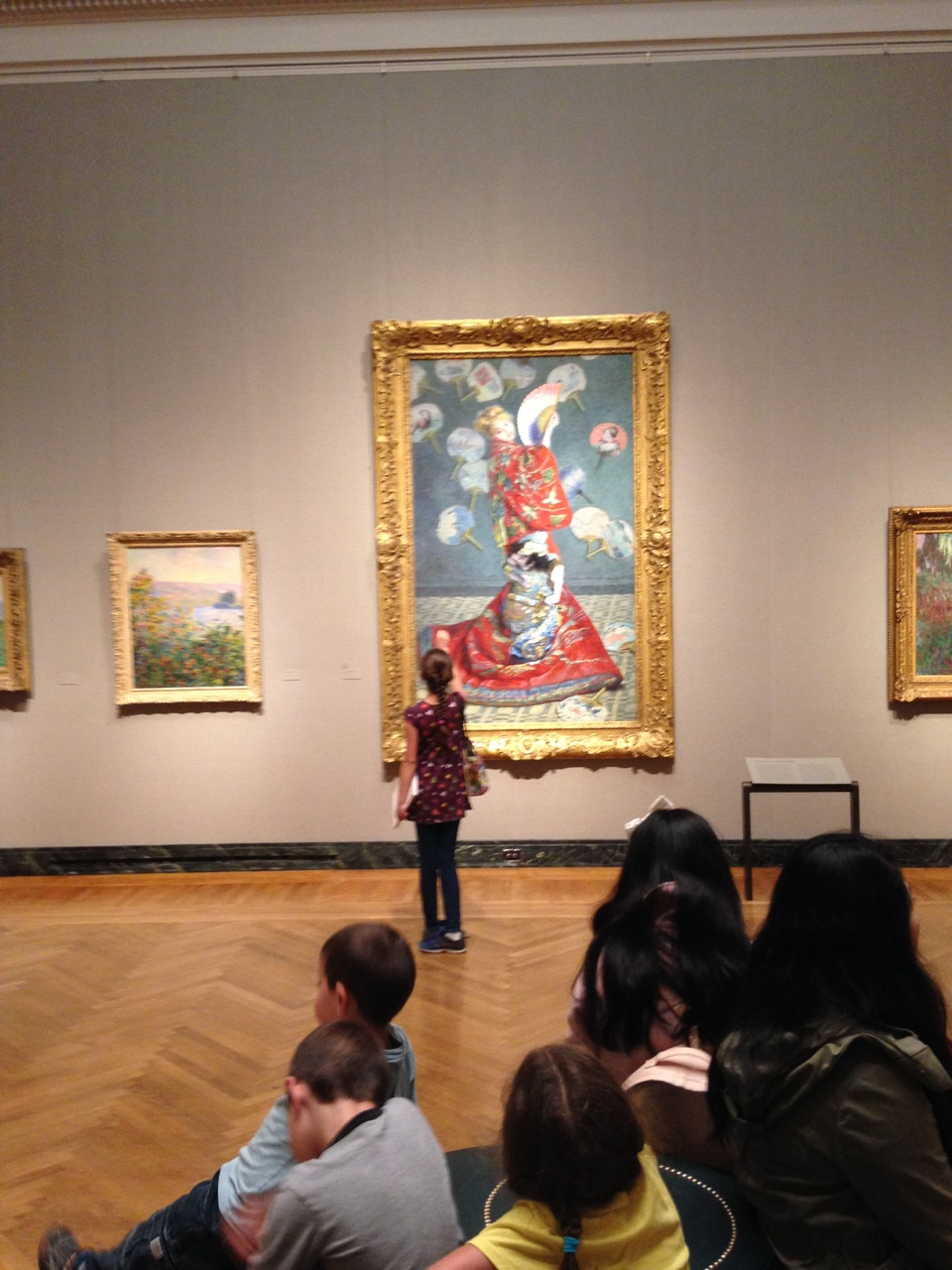 Bella examines Monet's dramatic painting of his wife in a kimono.