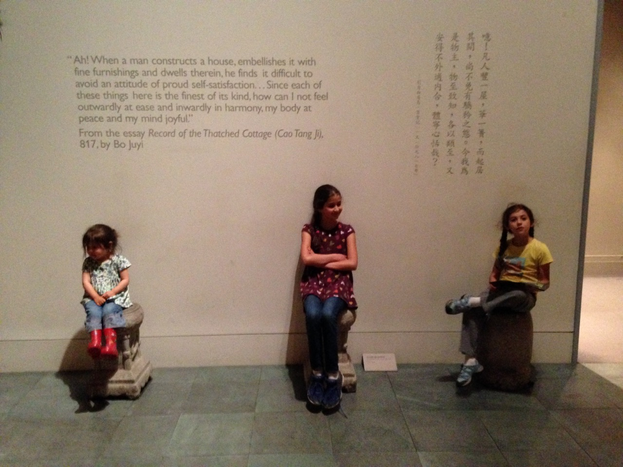 "Three girls on Chinese stools. (I love all the art chairs and benches and stools scattered throughout the museum that invite you to ""Take a seat."""