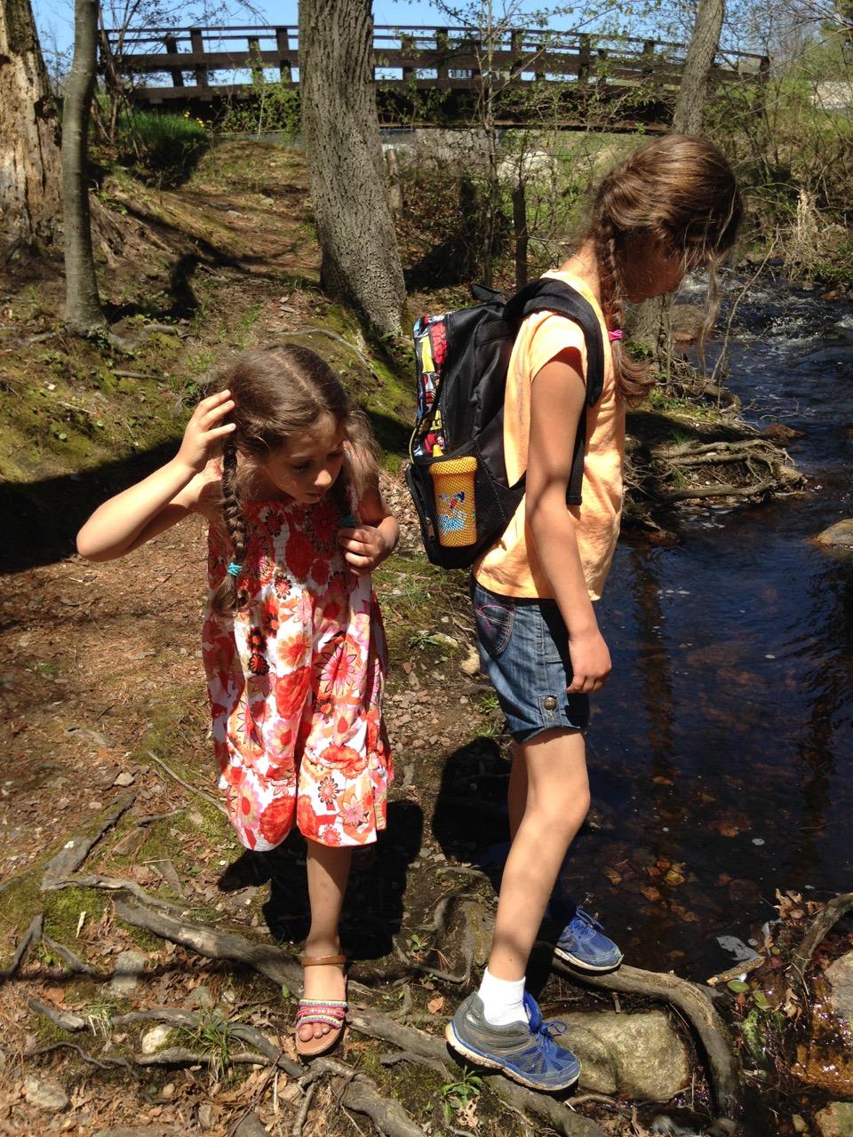 Bella and Sophie explore the stream