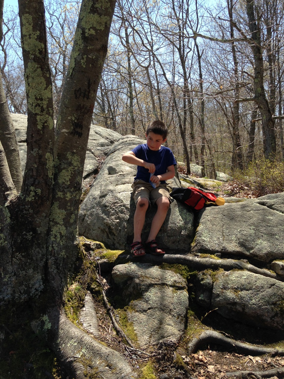 Ben picnics on the rock.