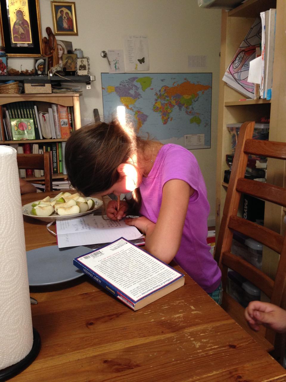 Bella journaling at dinner time.