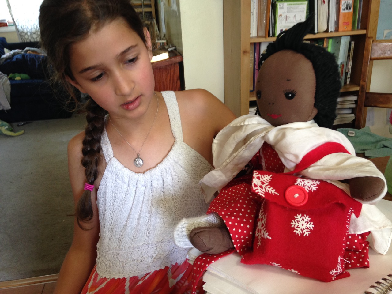 Bella made a bag for her doll. With blanket stitching on the buttonhole and everything.