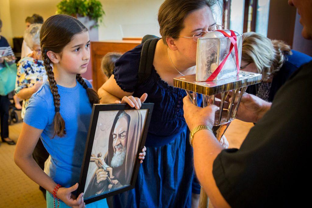 Venerating Padre Pio's heart.